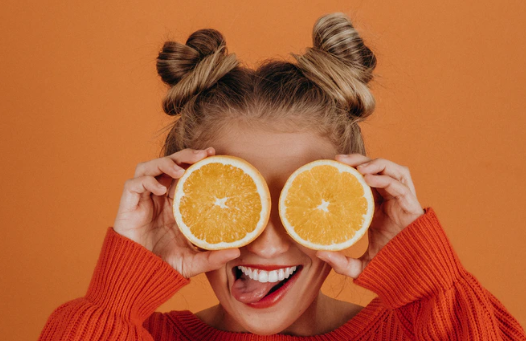 girl with vitamin c and oranges